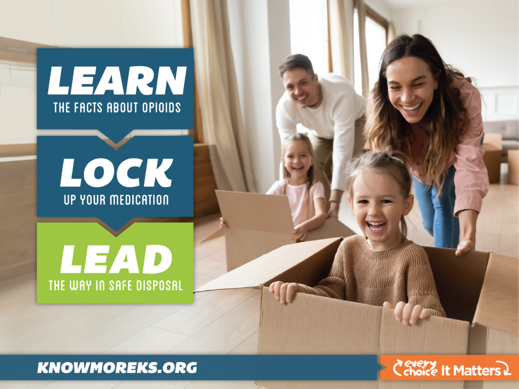two children sitting in cardboard boxes while their parents push them across the floor in a race